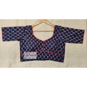 blue ajrak with red piping blouse