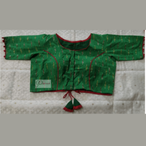 Green Ikkat Blouse With Red Piping And Frill